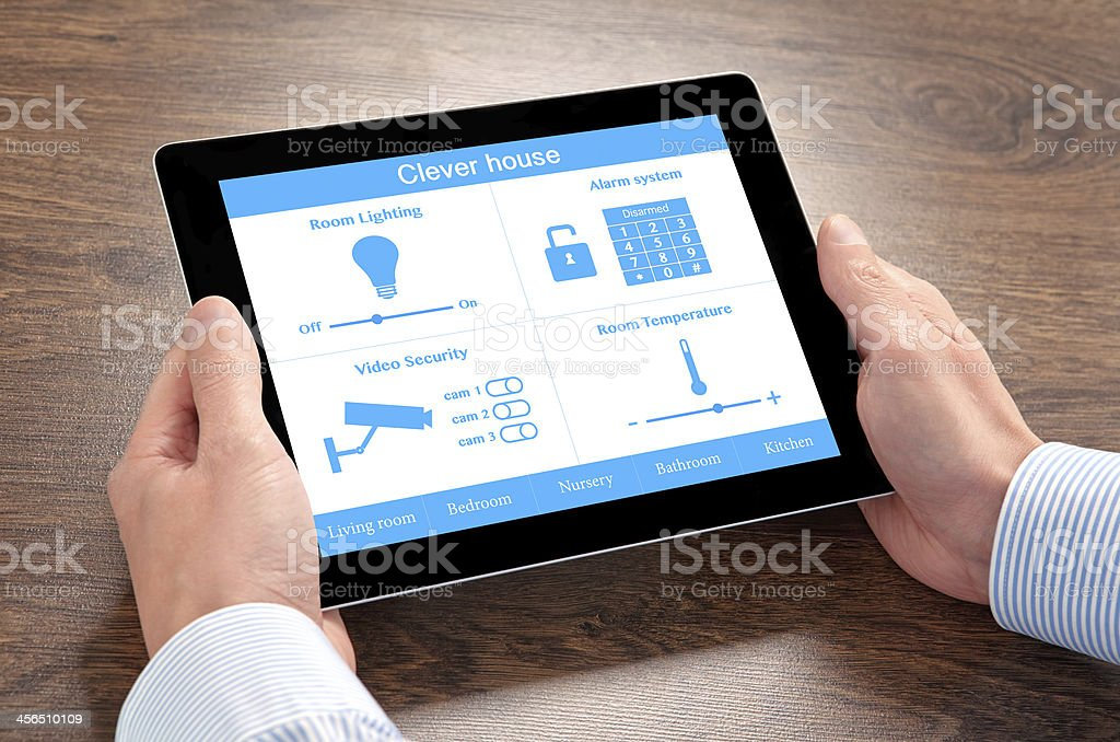 businessman holding a tablet computer with system clever house royalty-free stock photo