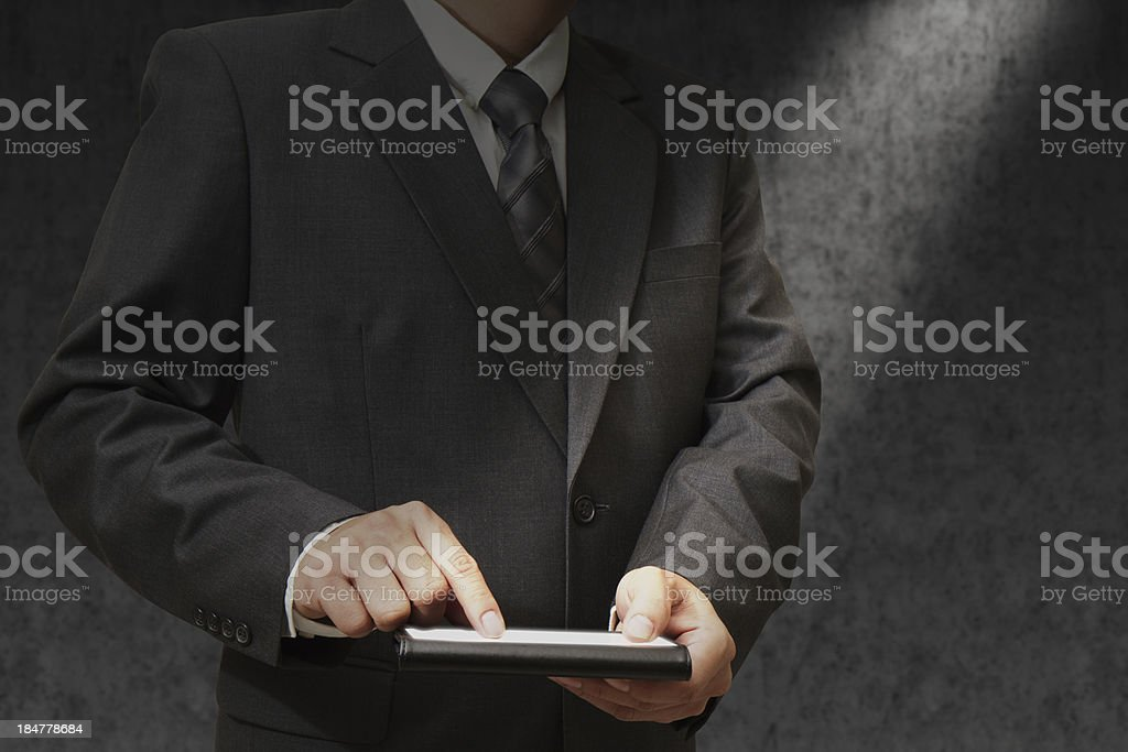 Businessman holding a touchpad royalty-free stock photo