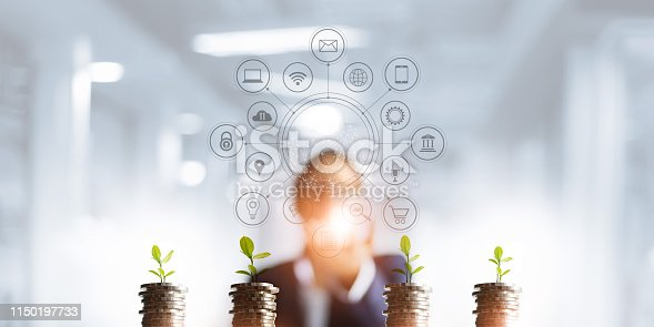 istock Businessman holding a tree sprout growing on coins, abstract growth investing. Finance and icon customer, banking network connection, digital marketing, investment growth and business technology. 1150197733