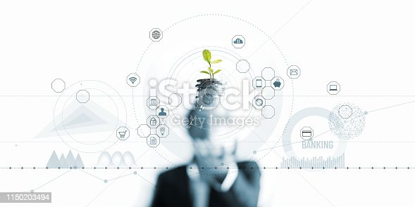 istock Businessman holding a tree sprout growing on coins, abstract growth investing. Finance and icon customer, banking network connection on interface, digital marketing, investment growth and business technology concept 1150203494