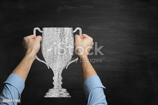 istock Businessman holding a trophy  drawn on blackboard 502641768