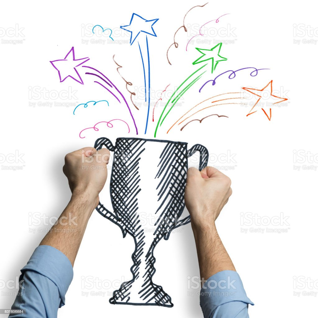 Businessman holding a trophy drawn on whiteboard stock photo