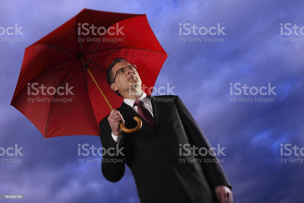 Businessman Holding a Umbrella royalty-free stock photo