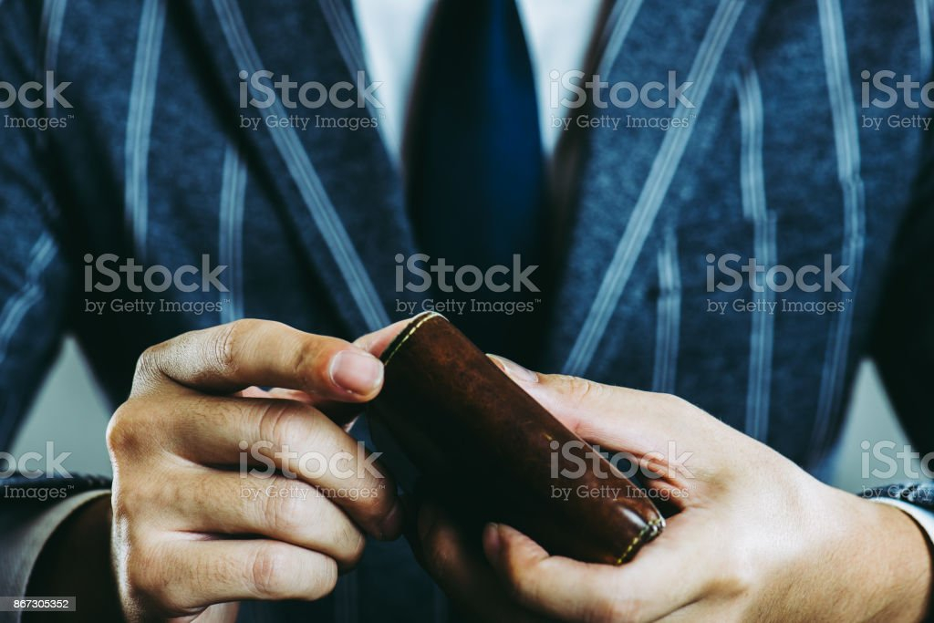 Businessman holding a wallet stock photo
