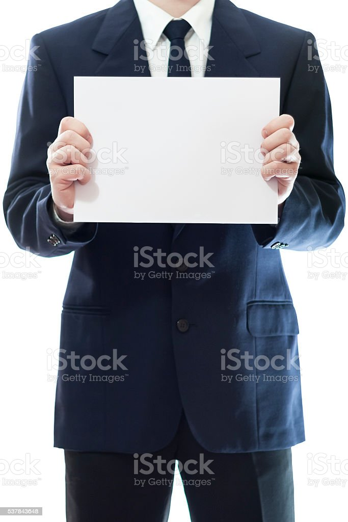 Businessman holding a white piece of paper stock photo