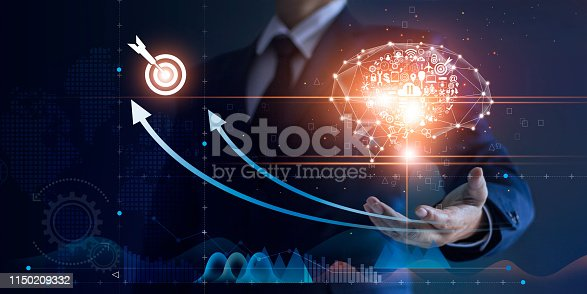 Businessman holding abstract brain and icon digital marketing, strategy and growth investment business target goal, media and technology.