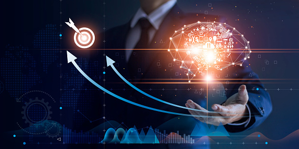 1025744818 istock photo Businessman holding abstract brain and icon digital marketing, strategy and growth investment business target goal, media and technology. 1150209332