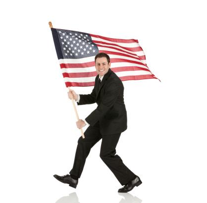Businessman holding an American flag