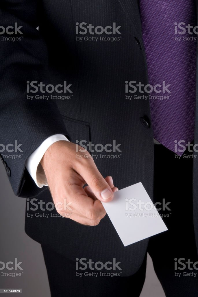 Businessman holding an empty business card royalty-free stock photo