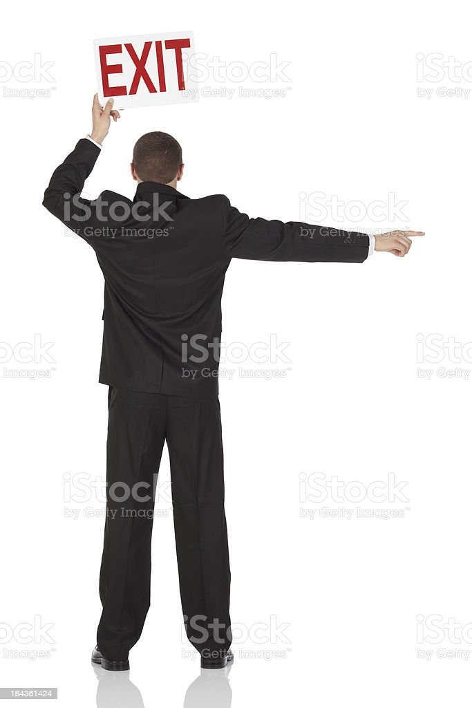 Businessman holding an exit signboard royalty-free stock photo