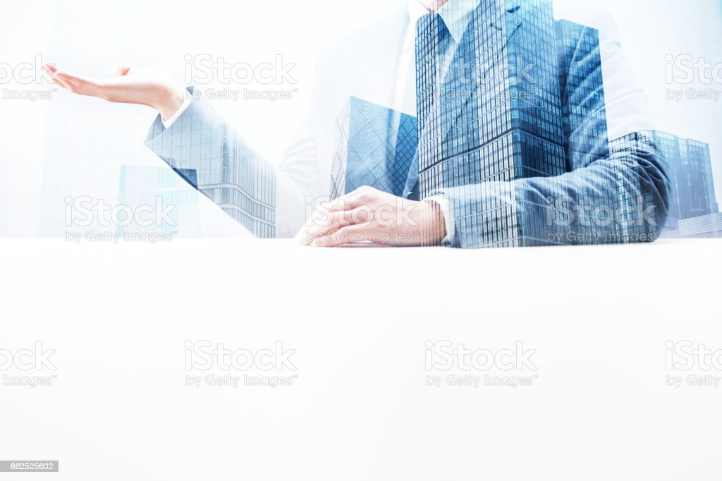 Businessman Holding an Invisible Product with Double Exposure Cityscape stock photo