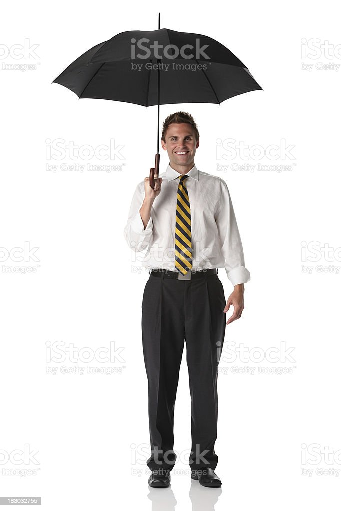 Businessman holding an umbrella royalty-free stock photo