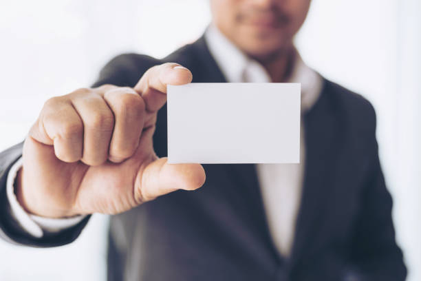 businessman  holding and showing empty business card or name card - business concept stock photo