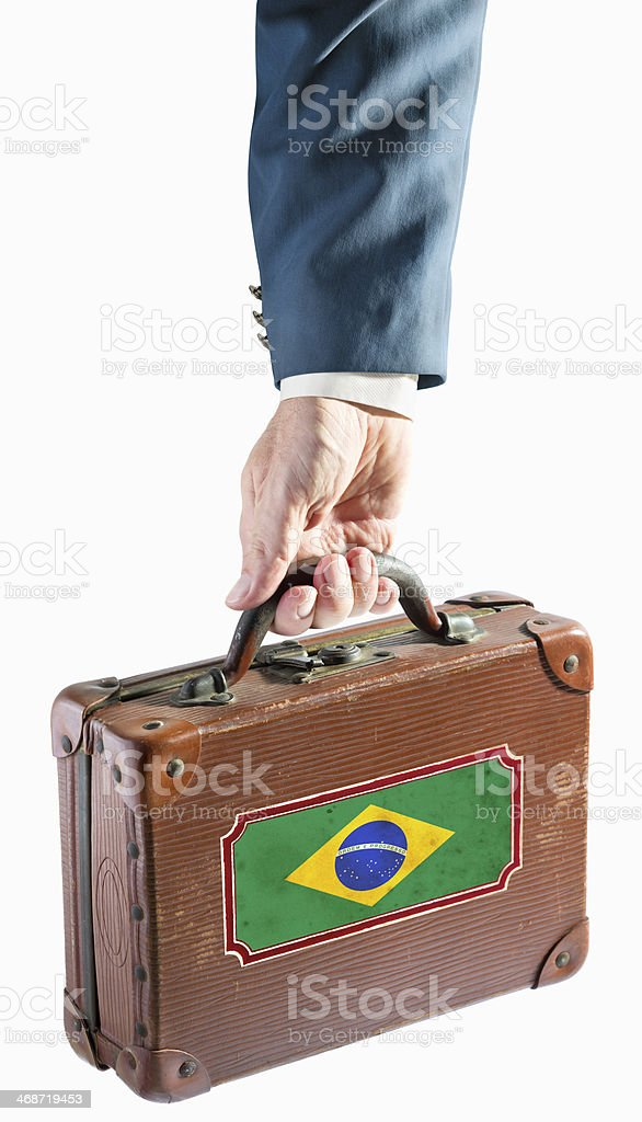 Businessman holding antique suitcase brazil flag stock photo