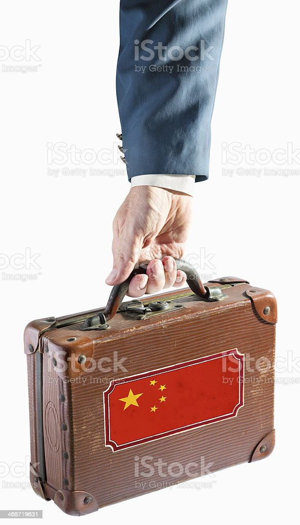 Businessman holding antique suitcase china flag royalty-free stock photo