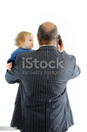 istock Businessman holding baby 117906331