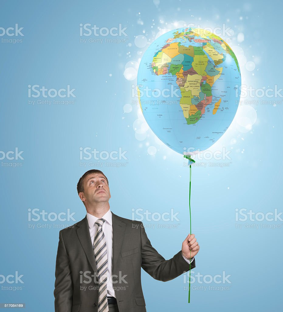 World Map Button Down Shirt.Businessman Holding Balloon With The Image Of World Map Stock Photo