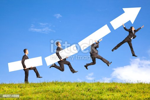 istock businessman holding blank and graph goes up to catch 463514699