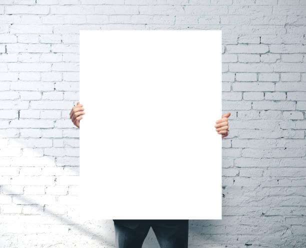 Businessman holding blank banner stock photo