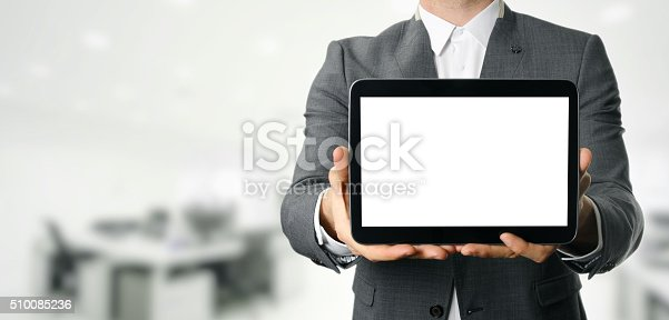 899410700 istock photo businessman holding blank digital tablet with copy space 510085236