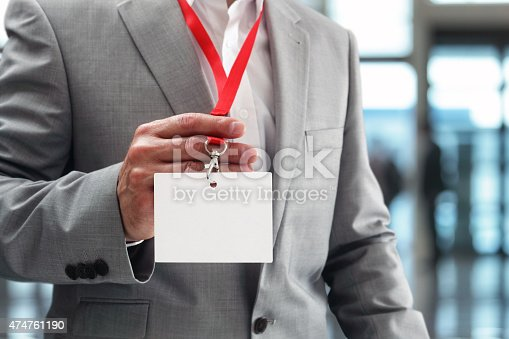 668954740istockphoto Businessman holding blank ID badge 474761190