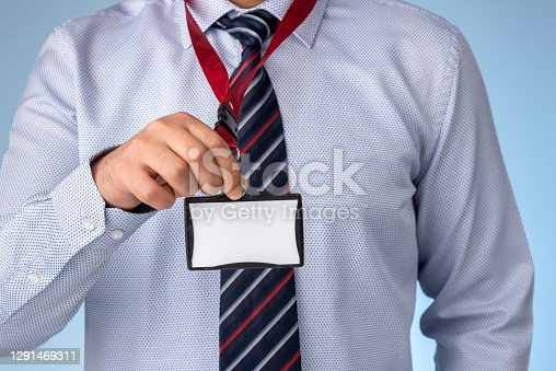 Businessman holding blank name tag