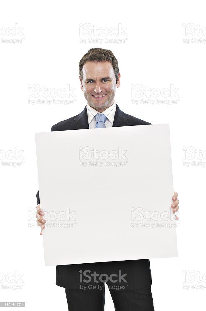 Businessman holding blank placard stock photo