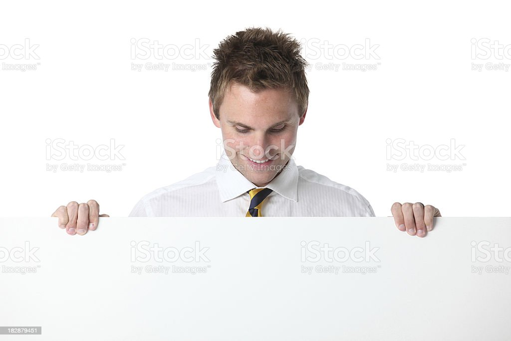 Businessman holding blank placard royalty-free stock photo