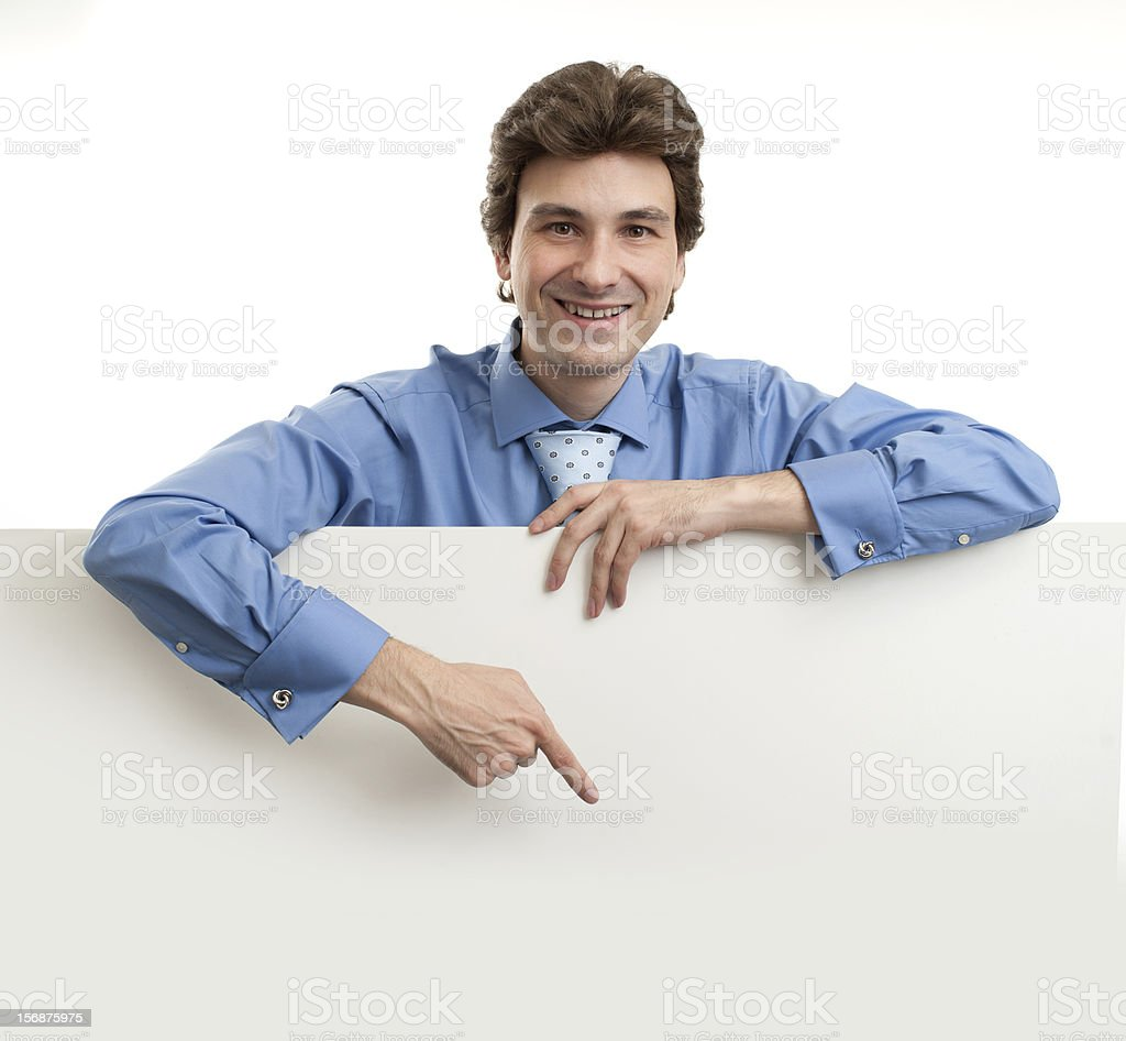 Businessman holding blank poster royalty-free stock photo