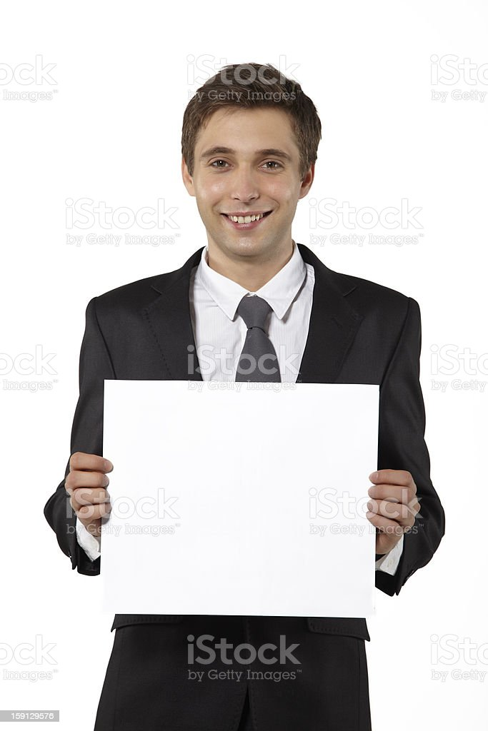 Businessman Holding Blank Sign on White royalty-free stock photo