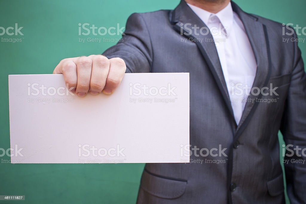 Businessman holding blank space showing information stock photo