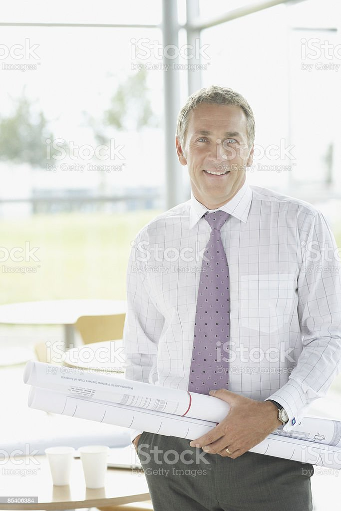 Businessman holding blueprints royalty-free stock photo