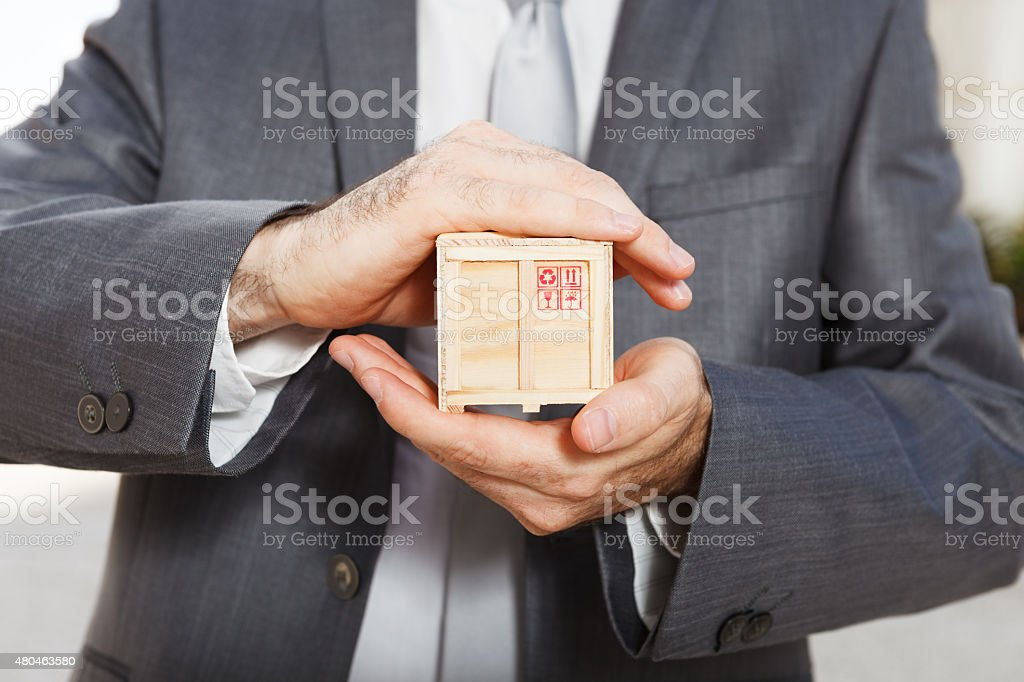 Businessman holding box Packing box in the hands of man 2015 Stock Photo