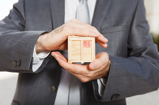 Businessman Holding Box Stock Photo - Download Image Now
