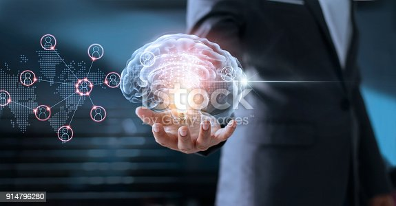 istock Businessman holding brain and light bulb with global networking connection, brainstorm and business concept 914796280