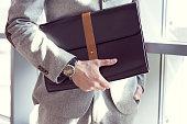 istock Businessman holding briefcase, close up 468102762