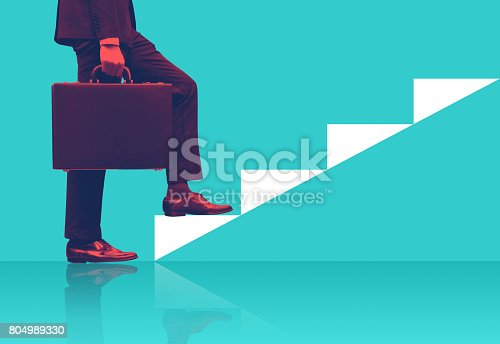 istock Businessman holding briefcase walking on graphic stair, start up business concepts. 804989330