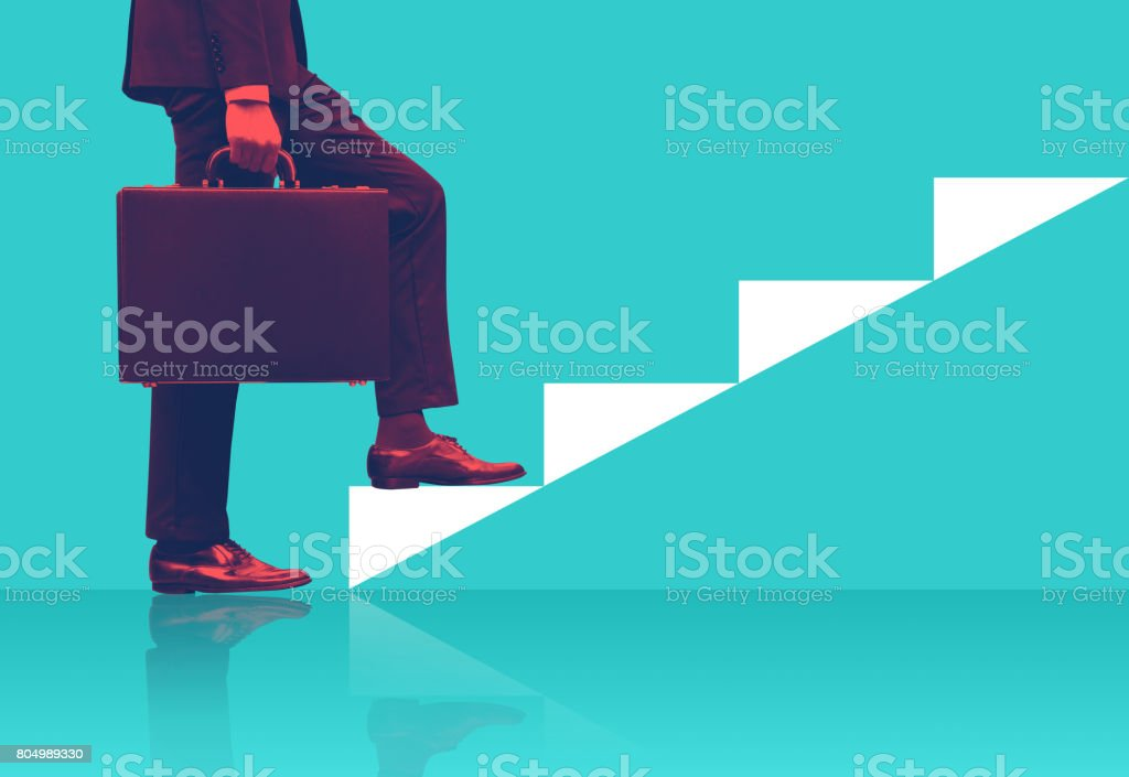 Businessman holding briefcase walking on graphic stair, start up business concepts. stock photo