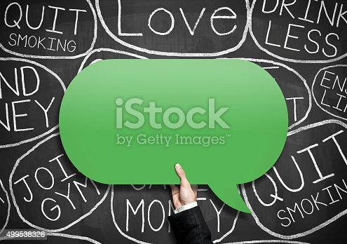 478203597 istock photo Businessman holding bubble speech (Click for more) 499538326