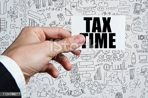 TAX TIME / Businessman holding business card with charts and diagrams on white background (Click for more)