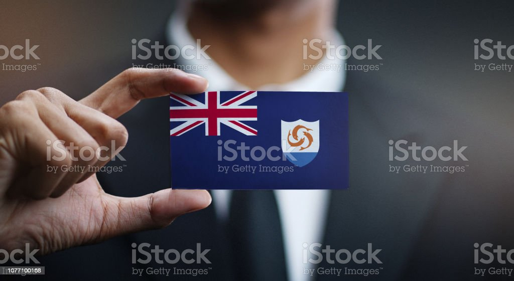 Businessman Holding Card of Anguilla Flag stock photo