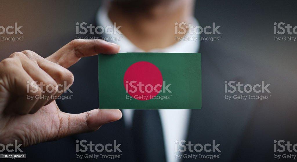 Businessman Holding Card of Bangladesh Flag stock photo
