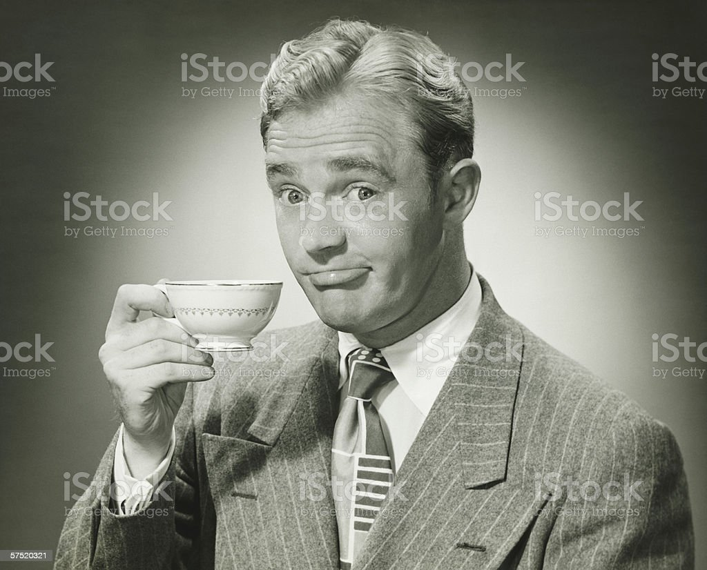 Businessman holding ceramic cup, (B&W), portrait royalty-free stock photo