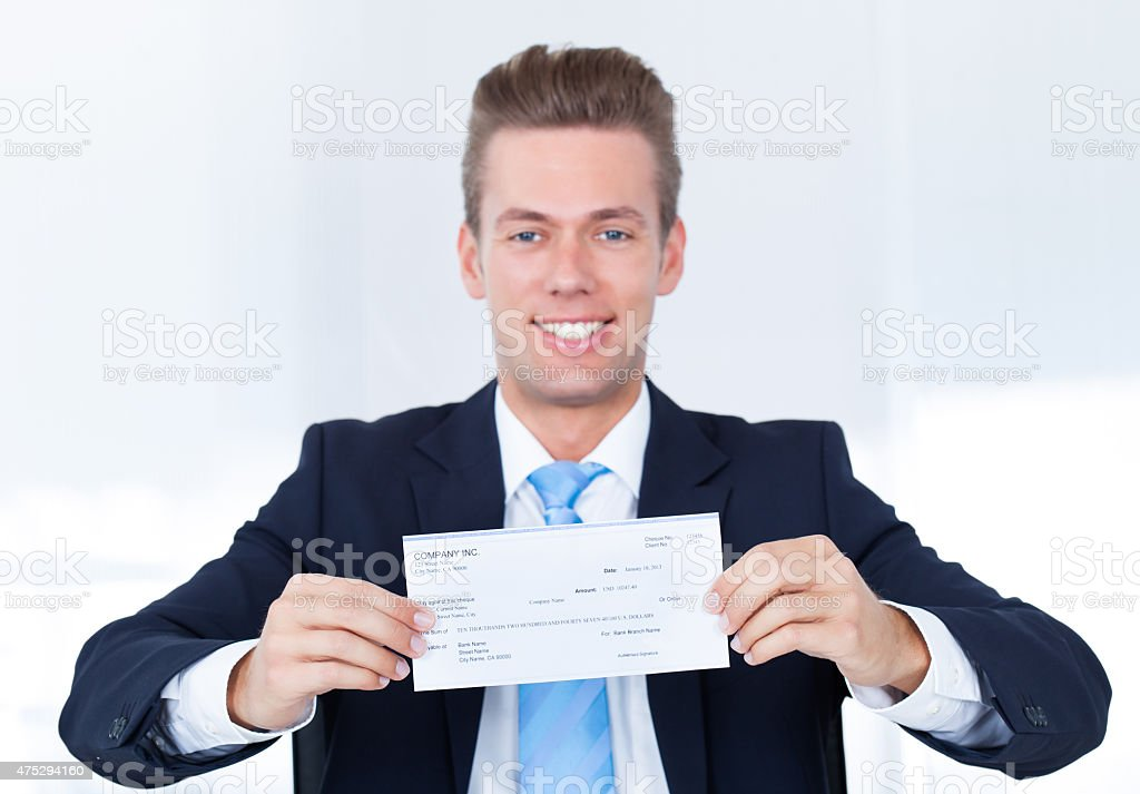 Businessman Holding Cheque stock photo