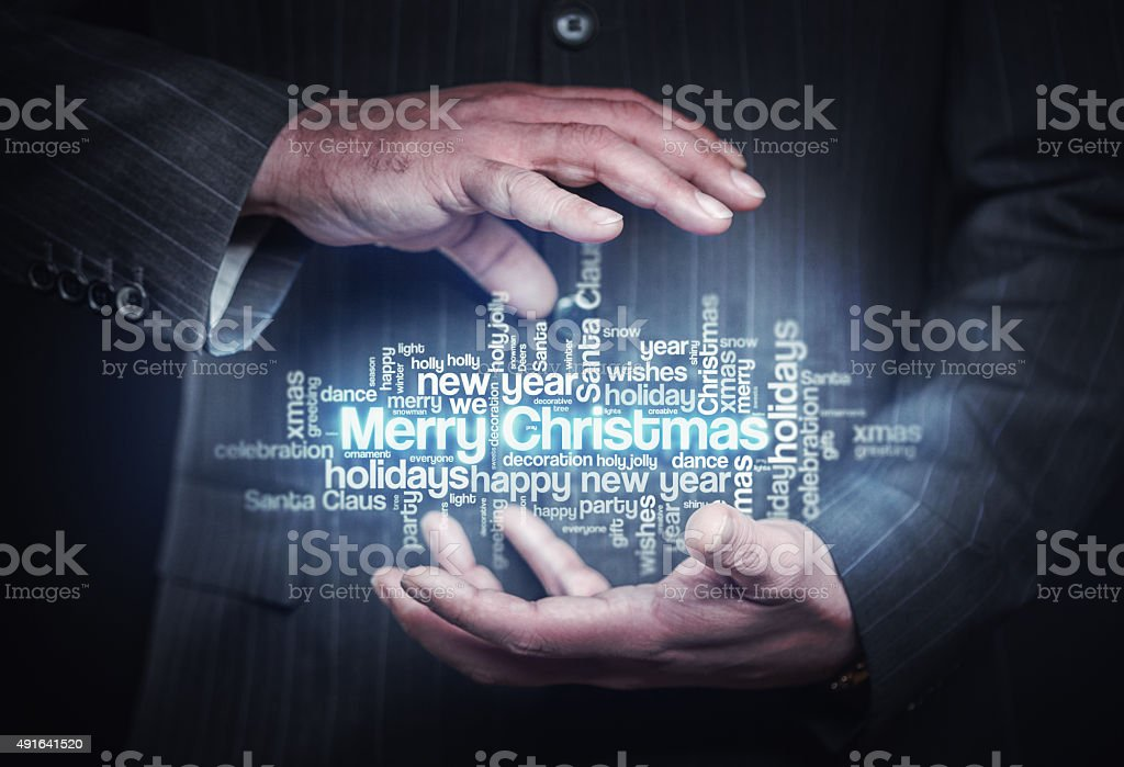 Businessman holding christmas word cloud. Business Background. Stock...