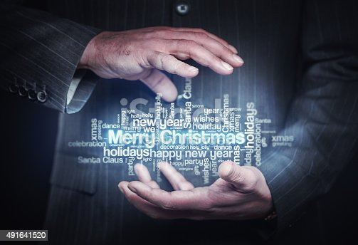 Businessman holding christmas word cloud. Business Background. Stock photo.