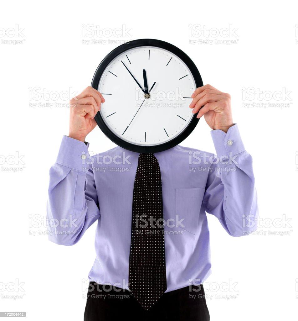 Businessman Holding Clock royalty-free stock photo