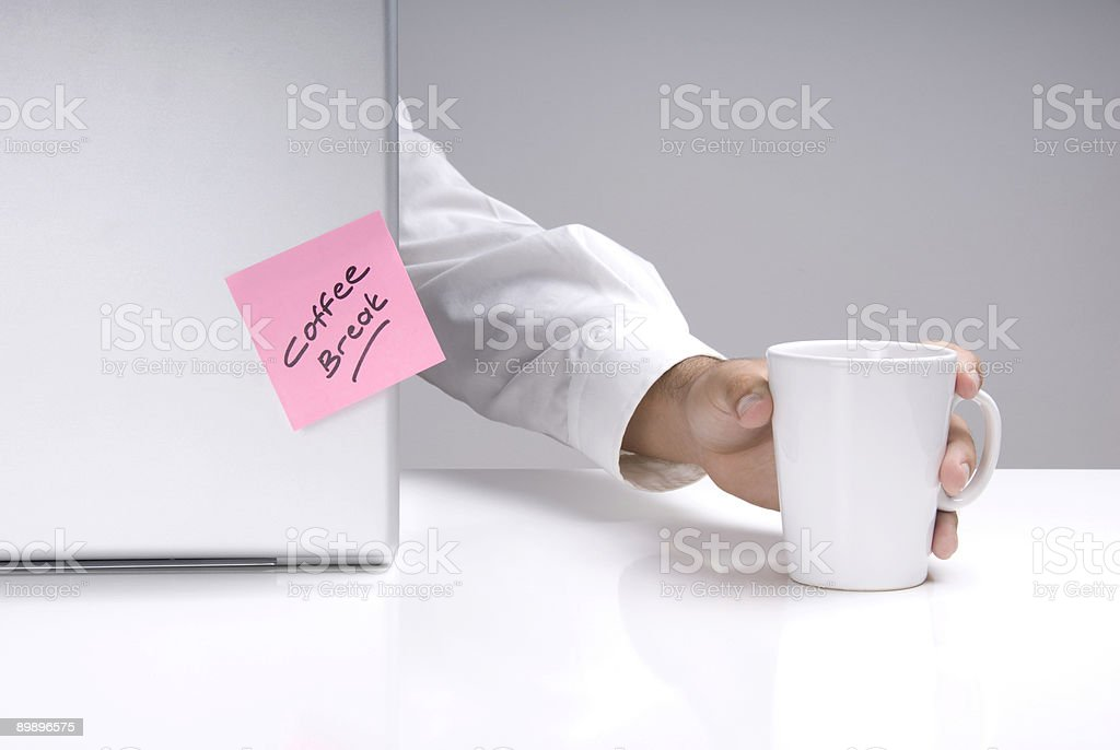 Businessman holding coffee mug royalty-free stock photo
