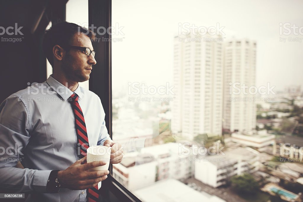 Businessman Holding coffee Thinking Relax Concept stock photo
