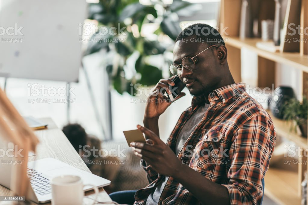 businessman holding credit card stock photo